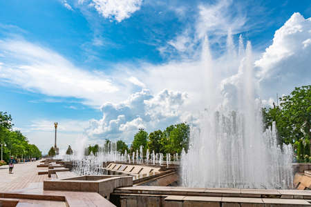 Dushanbe Independence Monument Breathtaking Picturesque View with Fountains on a Sunny Blue Sky Day