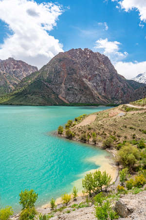 Sughd Iskanderkul Lake Breathtaking Picturesque View with and Snow Capped Mountains on a Sunny Blue Sky Day