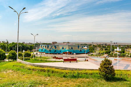 Khujand Ismoil Somoni Park View of 20 Year Anniversary of Tajikistan Independence Indoor Swimming Pool Building on a Sunny Blue Sky Day