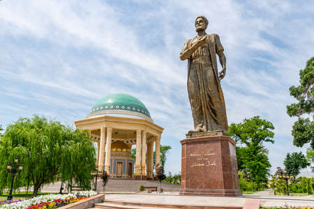 Khujand Kamoli Khujandi Park Picturesque View of Statue and Mausoleum on a Sunny Blue Sky Day