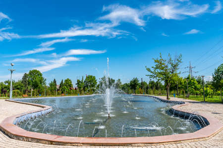 Dushanbe Youth Park Picturesque View of Pond with Fountains on a Sunny Blue Sky Day
