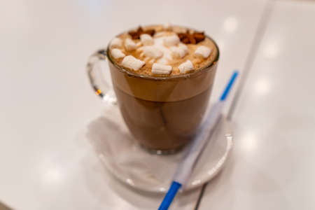 Tasty Traditional French Hot Chocolate Drink with Marshmallow Pieces in a Glass Фото со стока