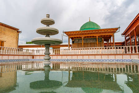 Istaravshan Hazrati Shoh Mosque Picturesque View of Fountain with Mausoleum on a Cloudy Rainy Day