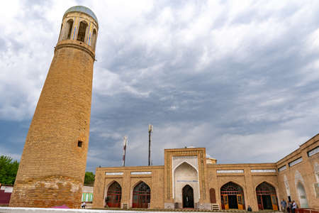 Isfara Abdullo Khan Mosque Madrasa Picturesque View of Minaret Tower and Iwan on a Cloudy Rainy Day Stock Photo
