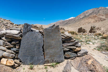 Pamir Highway Ratm Fort Ruins Wakhan Corridor View of Inscription Stone Billboards in Russian and English on a Sunny Blue Sky Day