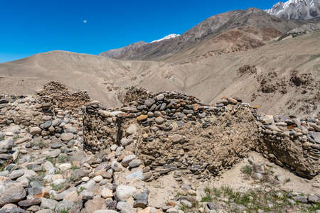 Pamir Highway Ratm Fort Ruins Wakhan Corridor View with Snow Capped Mountains on a Sunny Blue Sky Day