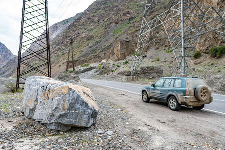 Ayni Dushanbe Highway M34 with Picturesque View of Parked SUV Jeep on a Cloudy Rainy Day Redactioneel