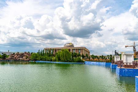 Dushanbe Flag Pole Park Picturesque View of Lake and Tajikistan National Museum on a Cloudy Blue Sky Day
