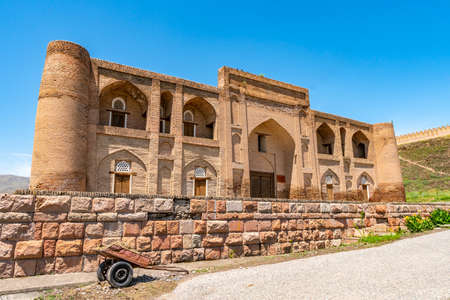 Hisor Fortress Madrasa Nav Picturesque Breathtaking View with Flowers on a Sunny Blue Sky Day