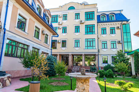 Hotel Picturesque Breathtaking Beautifully Decorated Garden Courtyard with House Building