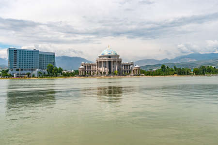 Dushanbe Komsomolskoe Lake Picturesque View of Hyatt Regency Hotel and Navruz Palace on a Cloudy Rainy Day