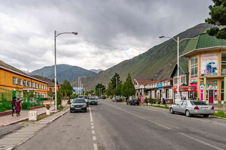 Ayni Town Picturesque Breathtaking View of Common Residential Buildings and Shops on a Cloudy Sky Day Редакционное