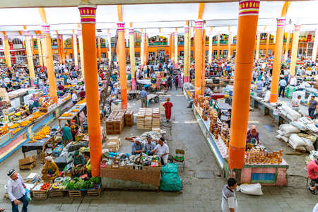 Khujand Panjshanbe Main Bazaar Picturesque Interior View and Market Stand on a Sunny Blue Sky Day Редакционное
