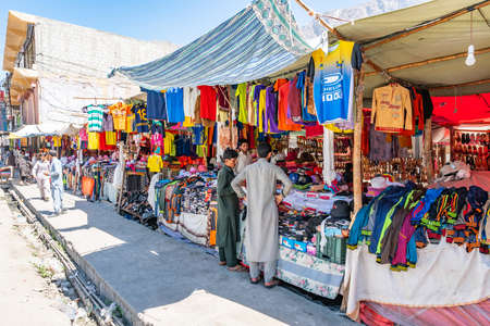 Gilgit Bazaar Street Picturesque View of Walking People Shops and Cars on a Sunny Blue Sky Day