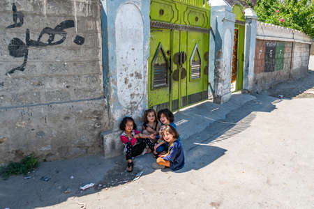 Gilgit Group of Little Girls is Playing at Residential Area Road on a Sunny Blue Sky Day
