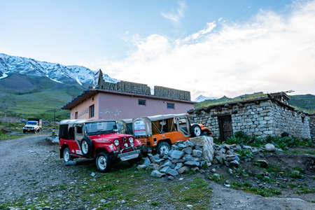 Deosai National Park Chilum Village Parked Jeeps at a Guesthouse in the Morning with Blue Sky