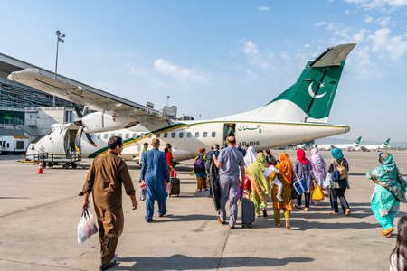 At Islamabad Airport Passengers are Waiting Outside for Boarding the Pakistan International Airlines Plane to Gilgit
