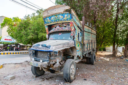 Hyderabad Typical Abandoned Traditional Pakistani Embroidered Truck without Lights on a Sunny Blue Sky Day