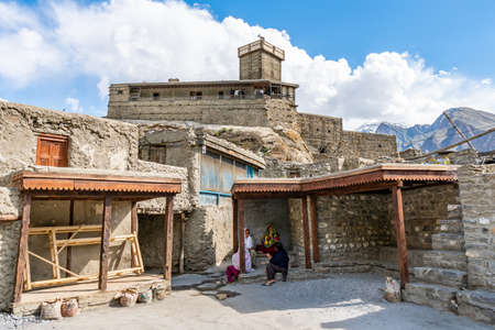 Karimabad Altit Town Picturesque View of Pakistani Local Women Sitting and Talking at the Old City on a Sunny Blue Sky Day