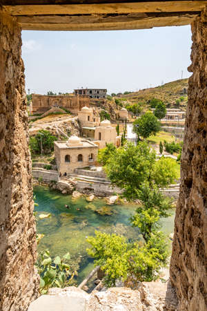 Chakwal Qila Katas Raj Hindu Temples Dedicated to Shiva Picturesque View of the Pond on a Sunny Blue Sky Day