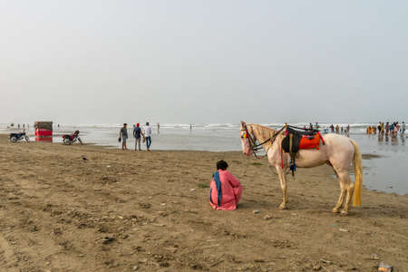 Karachi Clifton Beach Breathtaking Picturesque View of Guy with a White Horse at Morning on a Cloudy Day