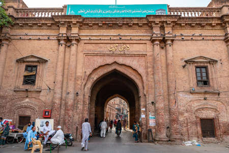 Lahore Historic Dehli Gate Picturesque View with People Entering and Exiting on a Sunny Blue Sky Day