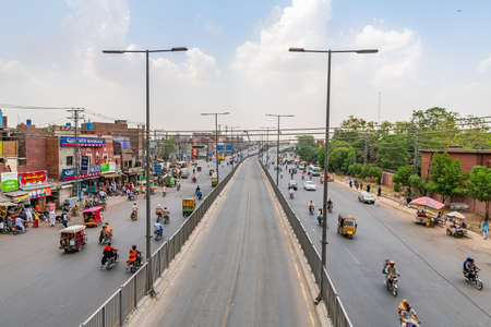 Lahore Data Darbar Road Picturesque View with Busy Traffic on a Cloudy Blue Sky Day