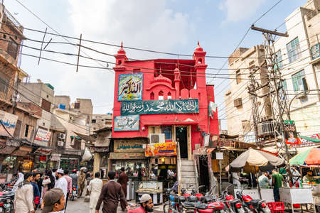 Lahore Walled City Picturesque View of a Red Colored Shrine on a Cloudy Blue Sky Day Stock Photo
