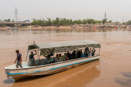 Lahore Ravi River Picturesque View of a Boat Full of Passengers on a Sunny Blue Sky Day Stock Photo