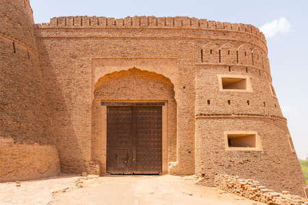 Derawar Bhatti Fort Walls Picturesque Breathtaking View of the Entrance Gate on a Sunny Blue Sky Day Stock Photo