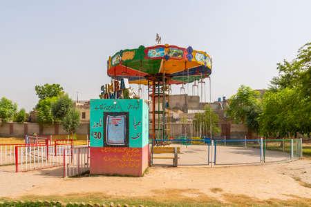 Multan Shah Shams Park Picturesque View of an Amusement Park Chair Carousel on a Sunny Blue Sky Day