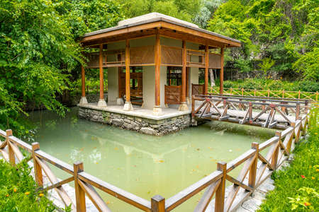 Shigar Fort Complex Picturesque Breathtaking View of the Pond Pavilion on a Cloudy Blue Sky Day Stock fotó