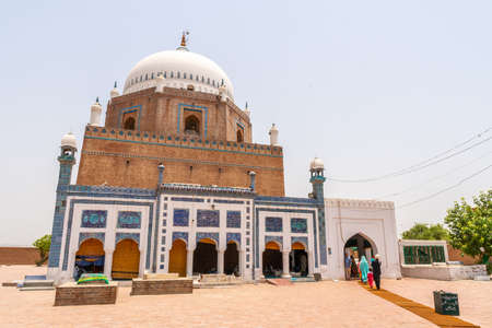 Multan Darbar Hazrat Bahauddin Zakariya Multani Tomb Visitors are Entering the Mausoleum on a Sunny Blue Sky Day