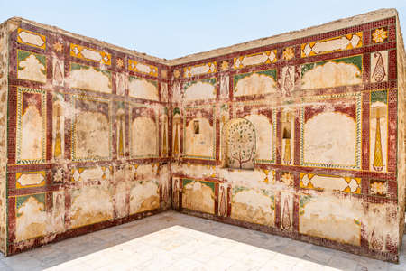 Chakwal Qila Katas Raj Hindu Temples Dedicated to Shiva Picturesque View of a Painted Wall on a Sunny Blue Sky Day