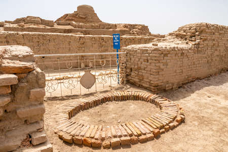 Larkana Mohenjo Daro Archaeological UNESCO World Heritage View of Oval Shape Well on a Sunny Blue Sky Day Editorial