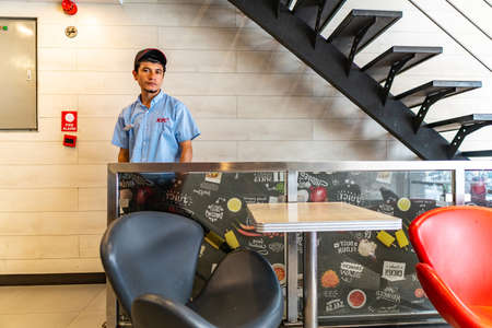 Karachi Picturesque View of a Young Handsome Pakistani Student Working at a KFC Fast Food Chain