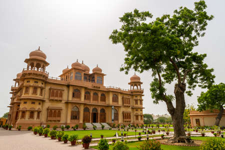 Karachi Mohatta Palace Museum Picturesque View at Hatim Alvi Road with Garden on a Cloudy Day