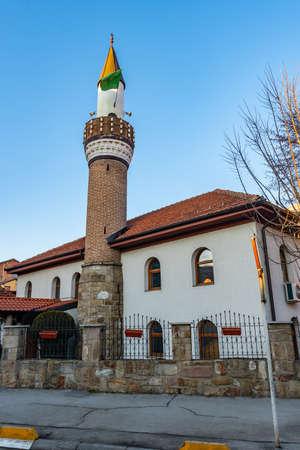 Novi Pazar Melajska Dzamija Mosque Picturesque View with Waving Green Colored Islamic Flag on a Sunny Blue Sky Day