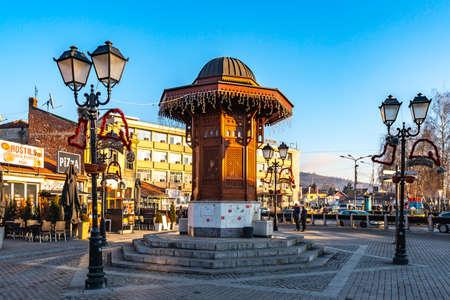 Novi Pazar Sebilj Wooden Fountain Picturesque View at 28th November Promenade Street on a Sunny Blue Sky Day