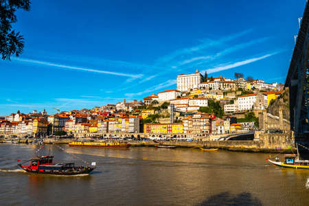 Porto Douro River Picturesque View of Ribeira District with Sailing Port Wine Ships on a Sunny Blue Sky Day in Winter