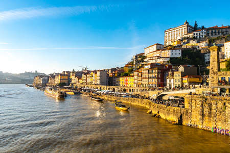 Porto Douro River Picturesque View of Ribeira District with Anchored Ships on a Sunny Blue Sky Day in Winter