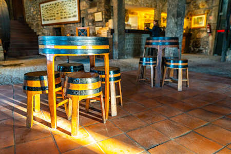 Porto Croft Port Wine Cellar Picturesque Interior View of Wine Barrel Table and Chairs
