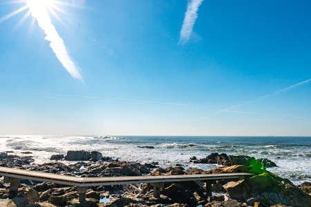Porto Homem do Leme Beach Picturesque View with Sun Rays on a Sunny Blue Sky Day 版權商用圖片