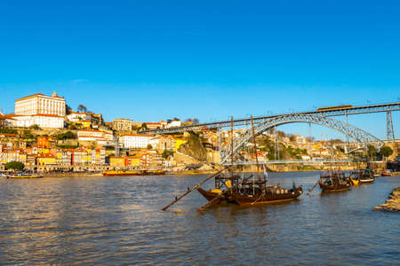 Porto Douro River Picturesque Low Angle View of Ribeira District with Anchored Ships on a Sunny Blue Sky Day in Winter