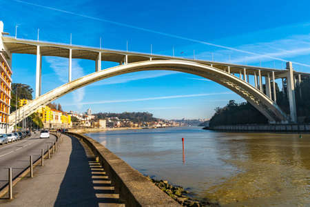 Porto Arrabida Bridge Breathtaking Picturesque View over the Douro River on a Blue Sky Day in Winter