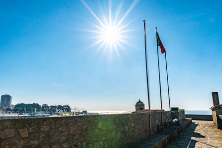 Porto Fort of Saint Francis Xavier Picturesque View with Waving Portuguese Flag on a Sunny Blue Sky Day