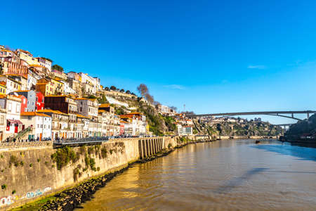 Porto Douro River Picturesque View of a Rua do Ouro Street with Arrabida Bridge on a Sunny Blue Sky Day in Winter