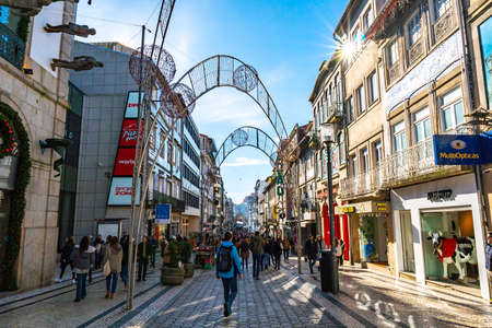Porto Via Catarina Shopping Street Picturesque View of Walking Pedestrians on a Blue Sky Day in Winter