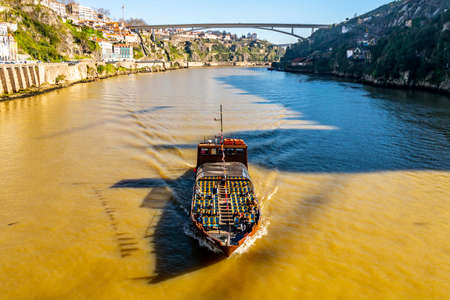 Porto Douro River Picturesque View of a Sailing Tourist Ship on a Sunny Blue Sky Day in Winter