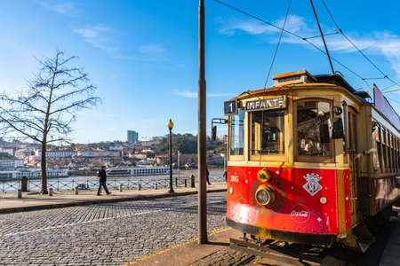 Porto Red Colored Retro Tramway Picturesque View at Rua Nova da Alfandega Street on a Sunny Blue Sky Day in Winter